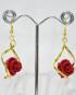 Orecchini dorati a spirale con rosellina